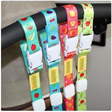 Лента-держатель для детских бутылочек на коляску